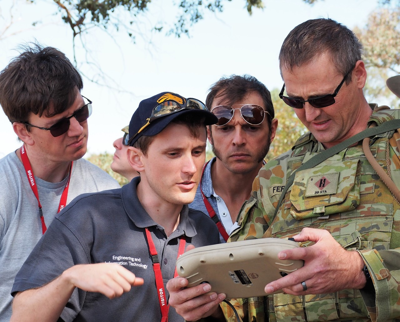 (L to R) AMME's Dr David Johnson, Matthew Anderson with AMSL Aero's Andrew Moore at the Australian Army event.