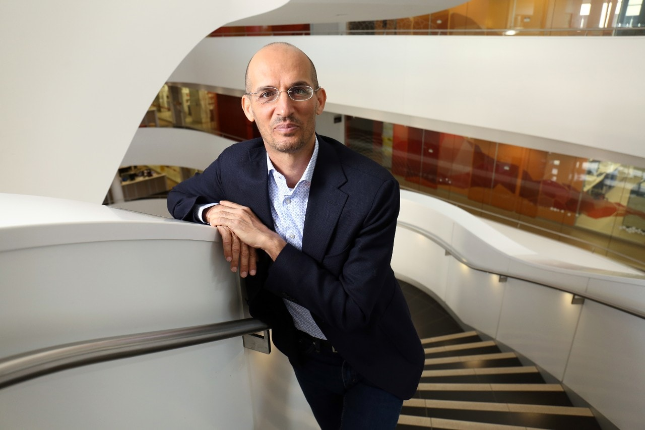 Professor Luigi Fontana leaning against stairs.