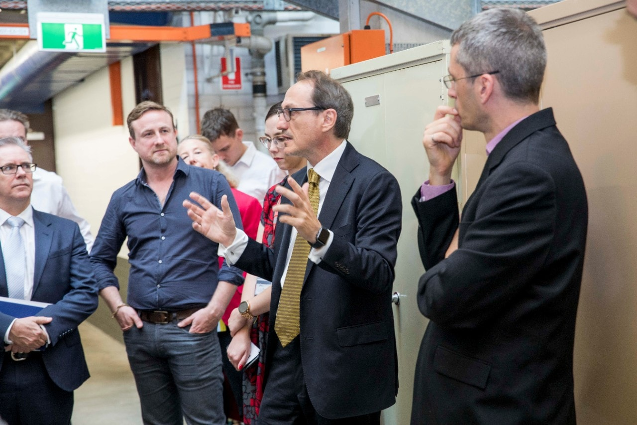 Representatives from GE Additive receiving a tour of the University's facilities with Professor Simon Ringer.