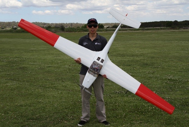 PhD candidate Andrew Gong with the aircraft used during the hydrogen fuel cell-powered flight trials in 2017.