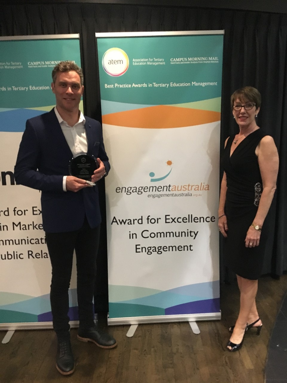 Jared Harrison and Fiona Sullivan from the Business School with the Engagement Australia Excellence in Community Engagement Award received at the 2018 Association for Tertiary Education Management best practice awards.