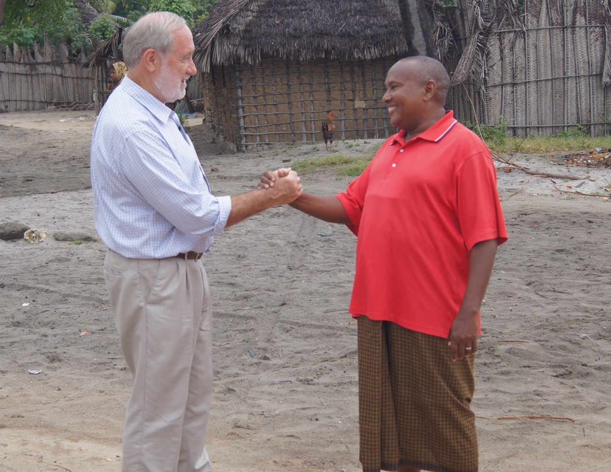 Professor Charles Mackenzie shaking hands with a patient in Tanzania