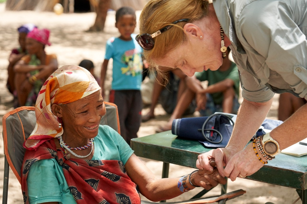 Photograph of Professor Vanessa Hayes taking a blood sample in Namibia.