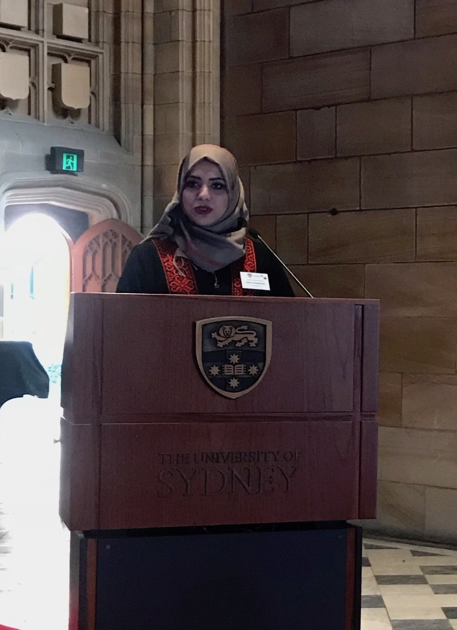 Heba al Hamarsheh speaking at the SICLE ceremony.