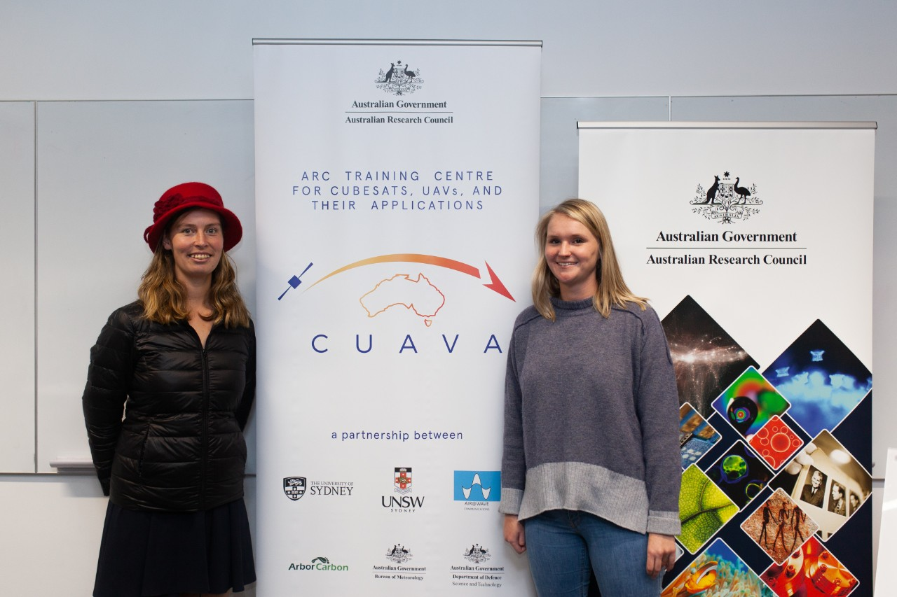 photo of two female PhD students at the CUAVA launch, Savannah McGuirk and Alexandra Jones