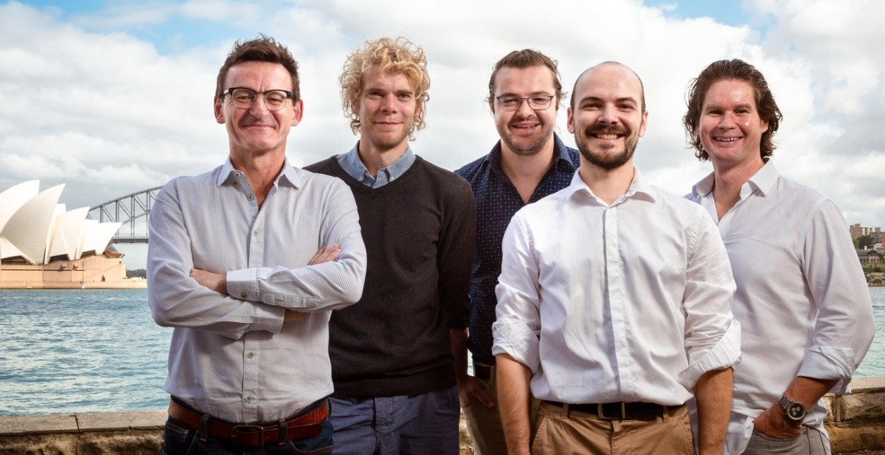 Photo of five scientists in front of the Sydney Opera House