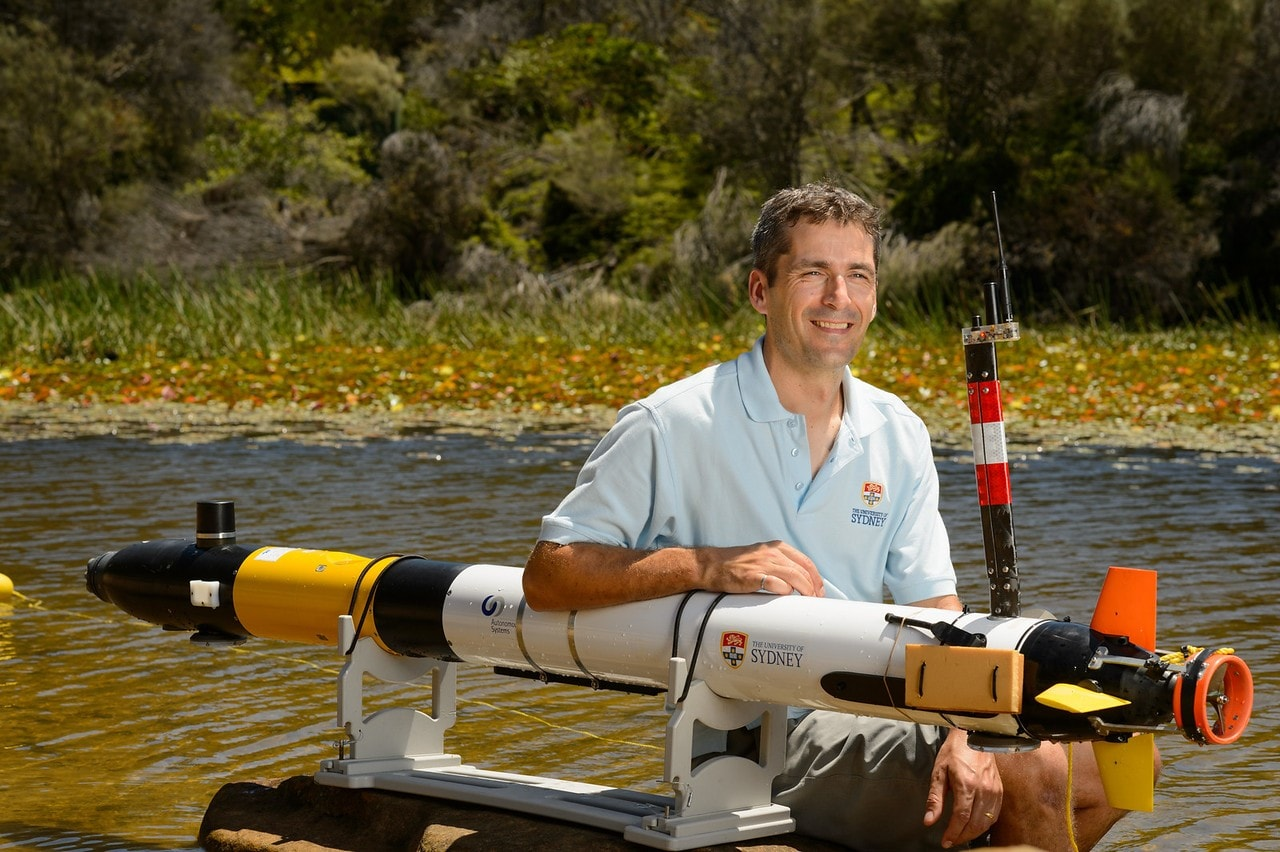 Professor Stefan Williams with an autonomous underwater vehicle.