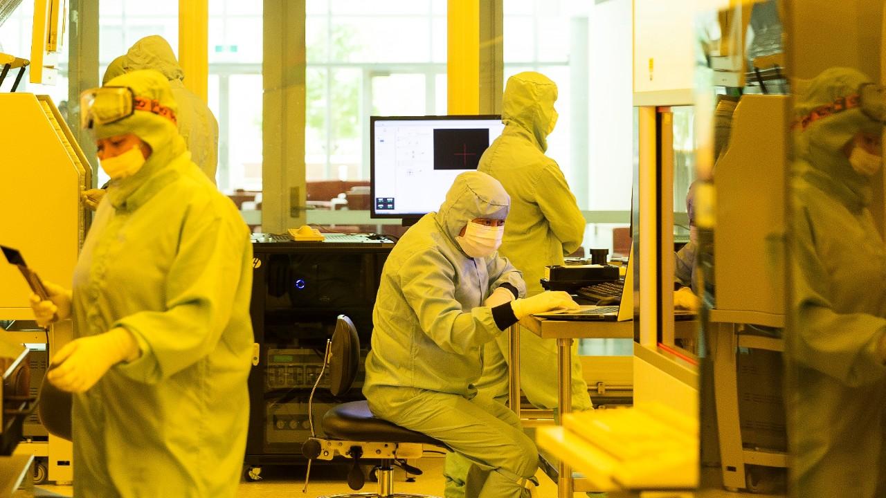 Technicians at work inside the Sydney Nanoscience Hub cleanroom.