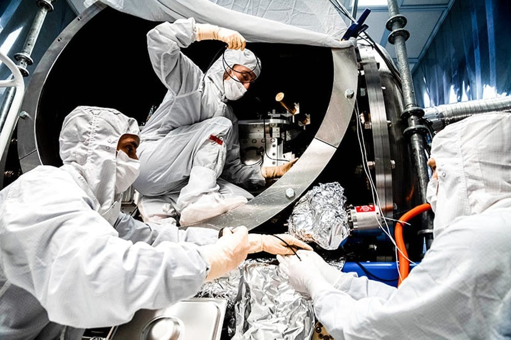 LIGO team members (left-to-right): Fabrice Matichard, Sheila Dwyer, Hugh Radkins) install in-vacuum equipment as part of the squeezed-light upgrade. Photo: Nutsinee Kijbunchoo/ANU