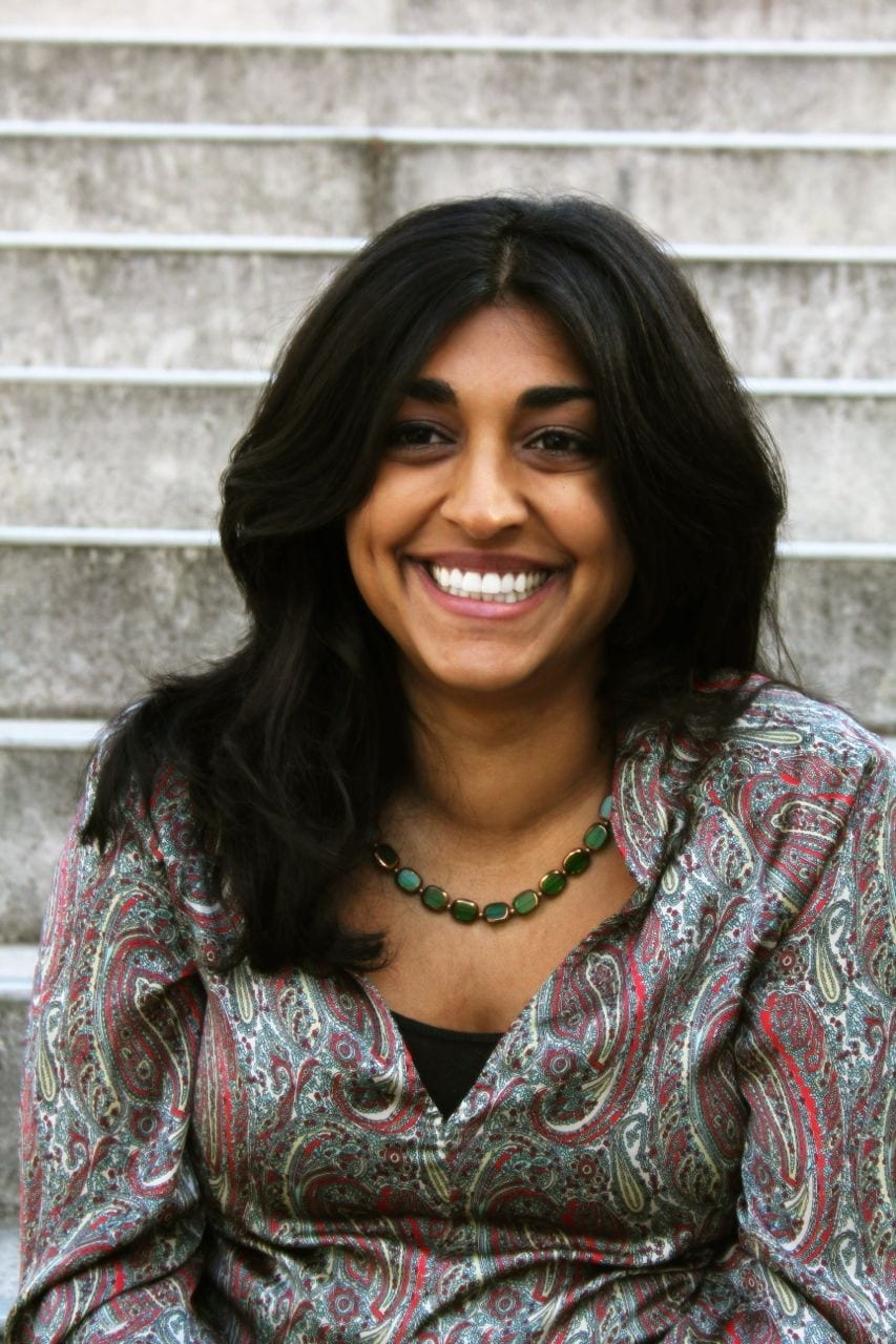 A photo of Rupal Isman, smiling.