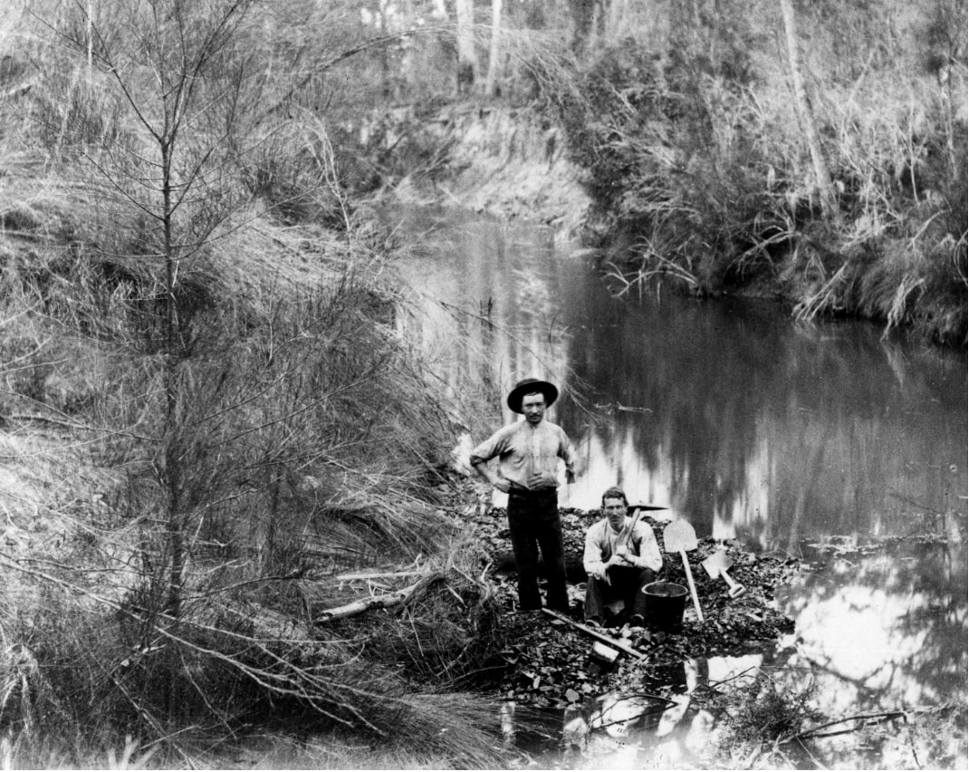David, with shouldered pic, and assistant Jack Rourke in 1886, having uncovered the Greta Coal Seam in Swamp (Deep) Creek near Abermain. Reproduced with permission from the University of Sydney Archives (G3_224_1589)