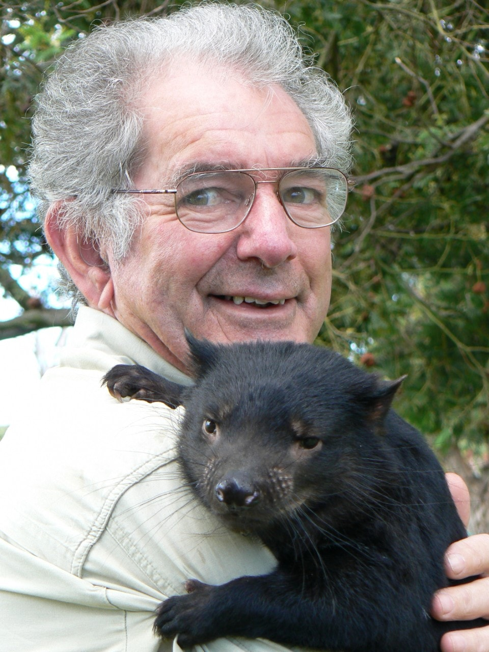 Photo of Bruce Englefield holding a Tasmanian devil