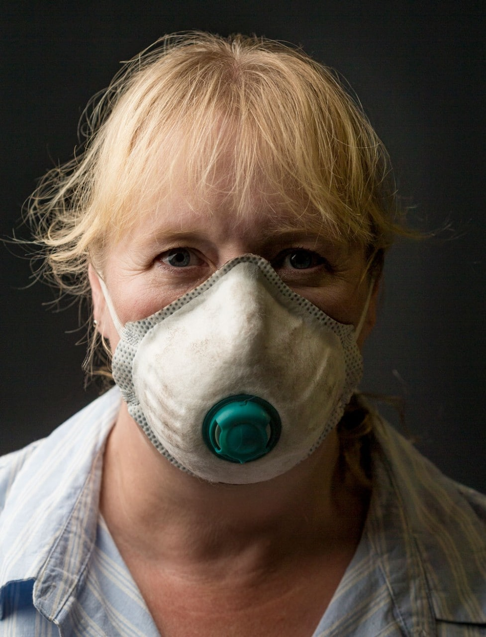 Dr Constance Lord wearing a dust mask