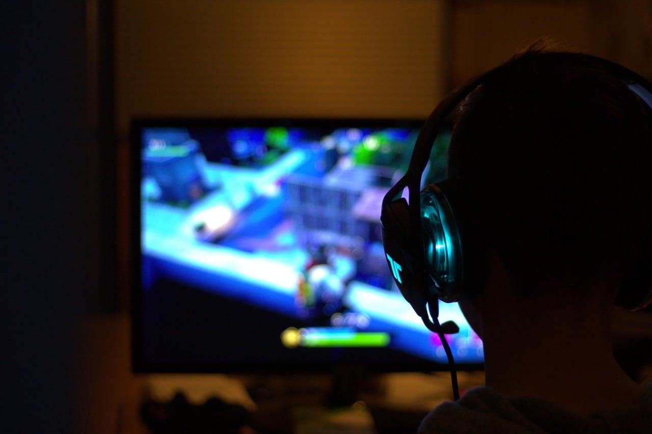photo of a child in the dark playing video games ,photo of a child in the dark playing video games
