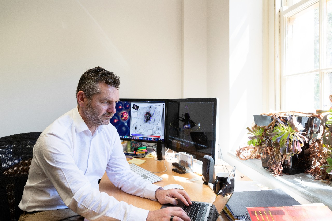 Professor Geraint Lewis in his office at the University of Sydney School of Physics.,