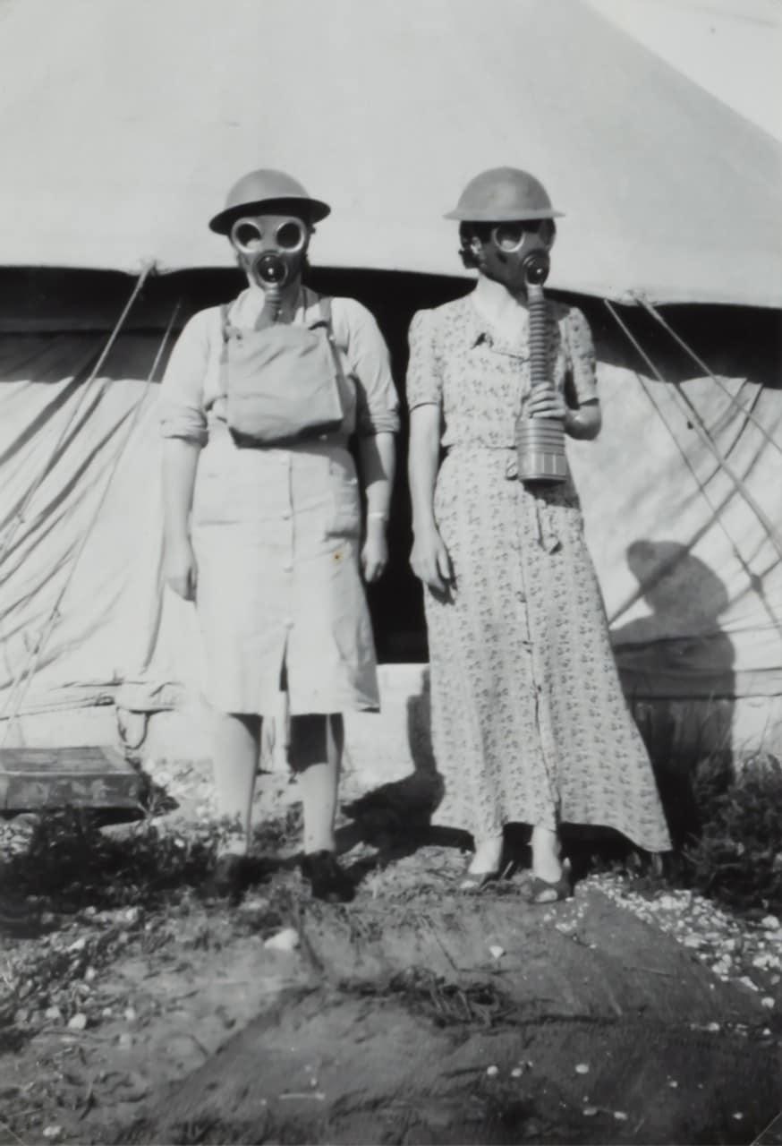 Two women wearing gas masks in Israel, World War II