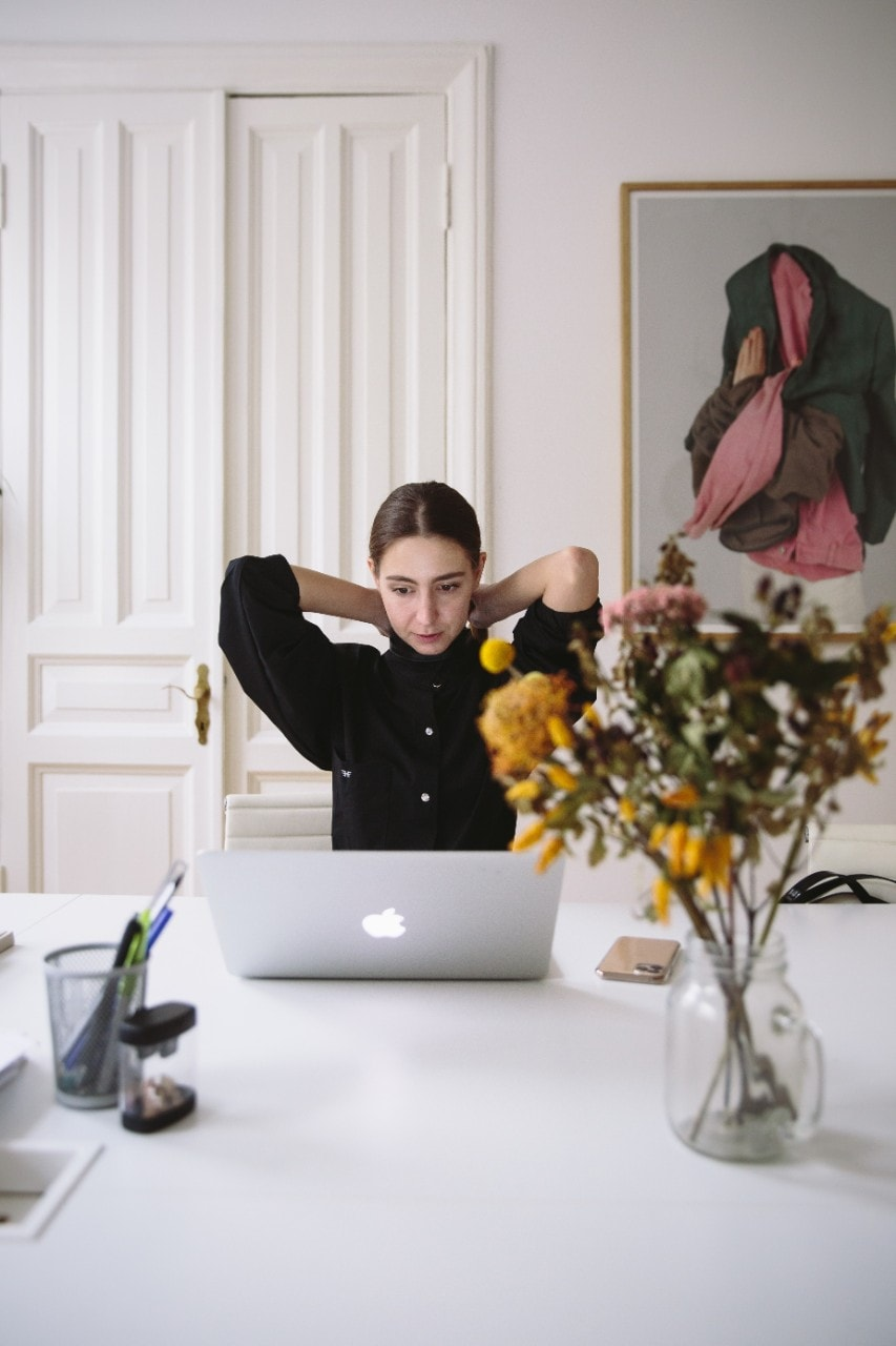 Woman working from laptop in kitchen