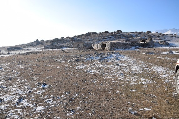 Traditional winter camp in south-facing sheltered location with low snow cover.