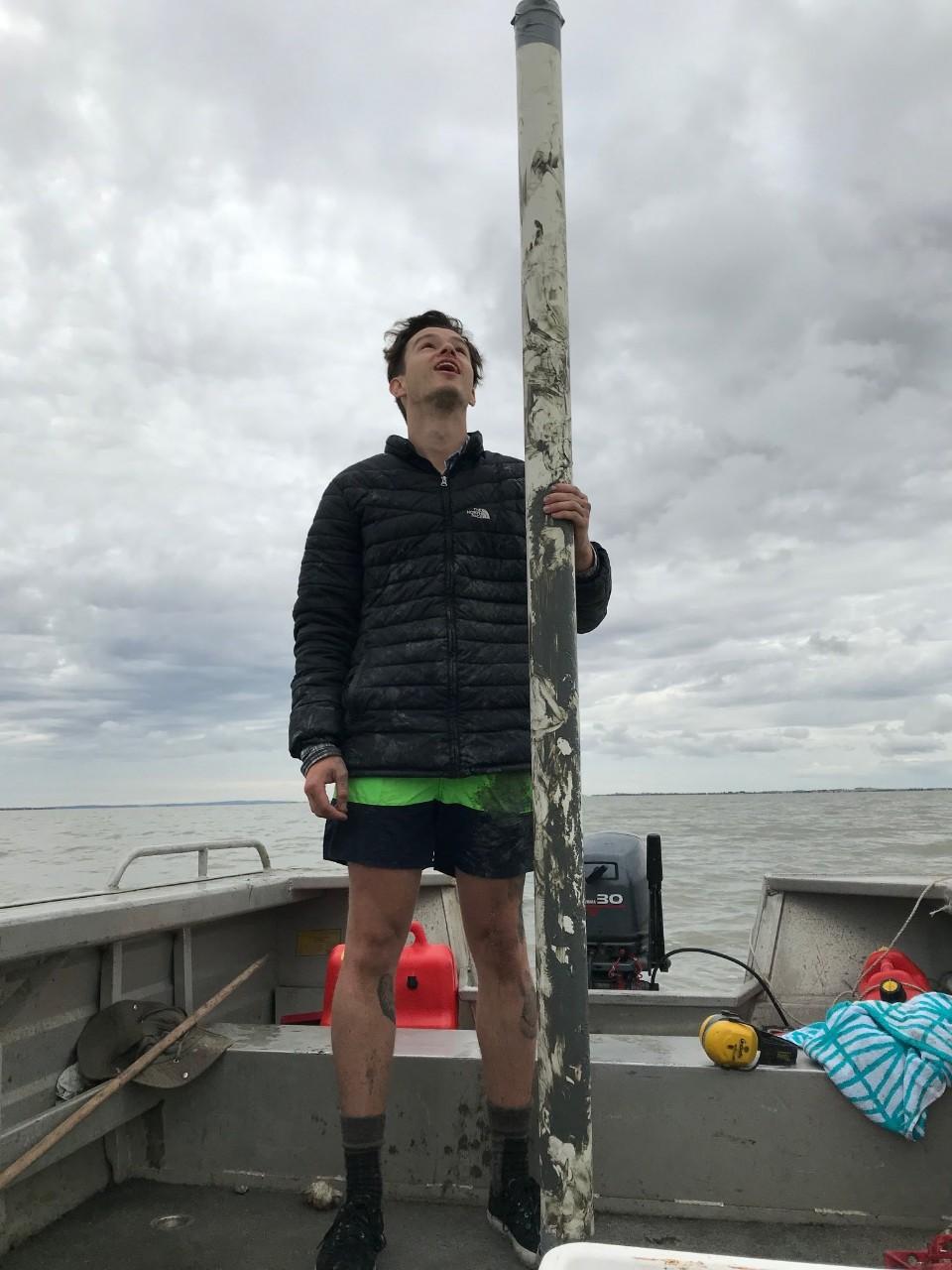 Dr Thomas Job taking core samples from Lake Albert.