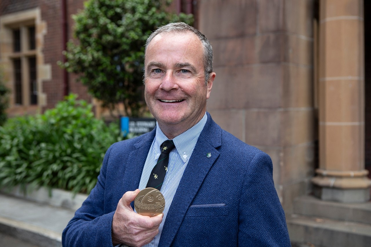 photo of Professor Paul McGreevy holding his medal
