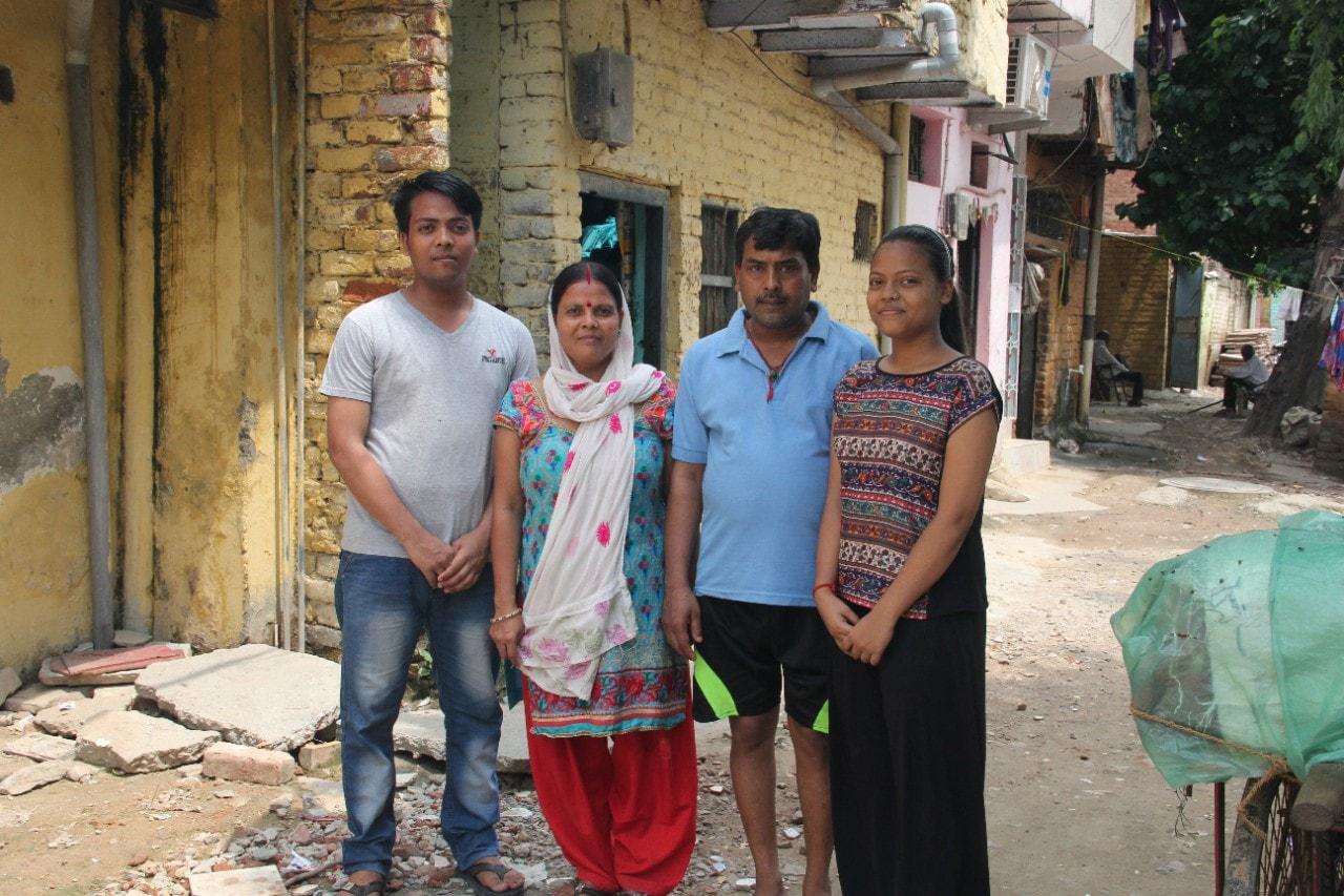 Tushar Joshi stands with mother Samta, father Santosh and sister Juhi in Mayapuri, west Delhi.
