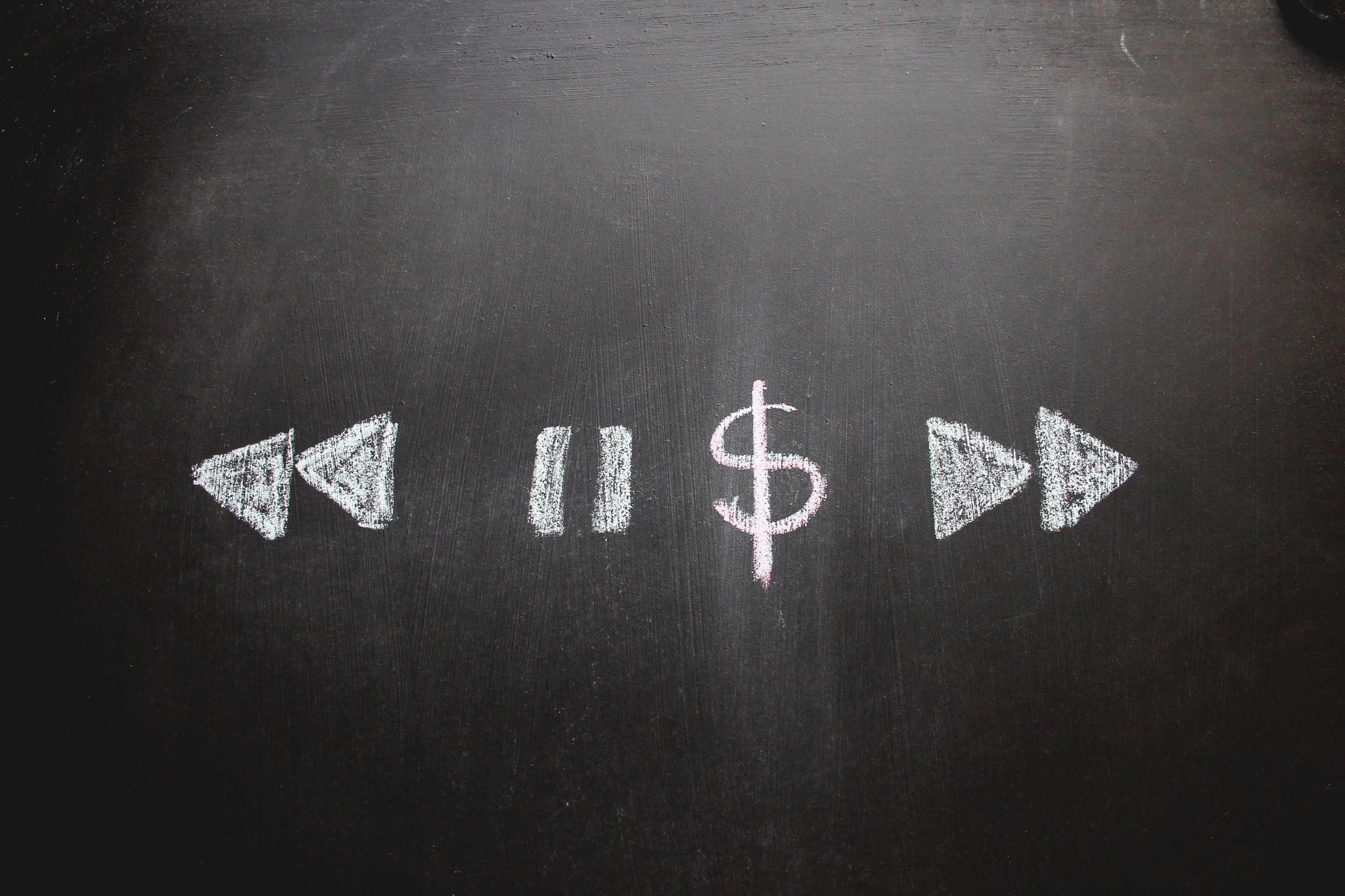 A dollar sign amongst pause, rewind and fast-forward signs. Image: iStock