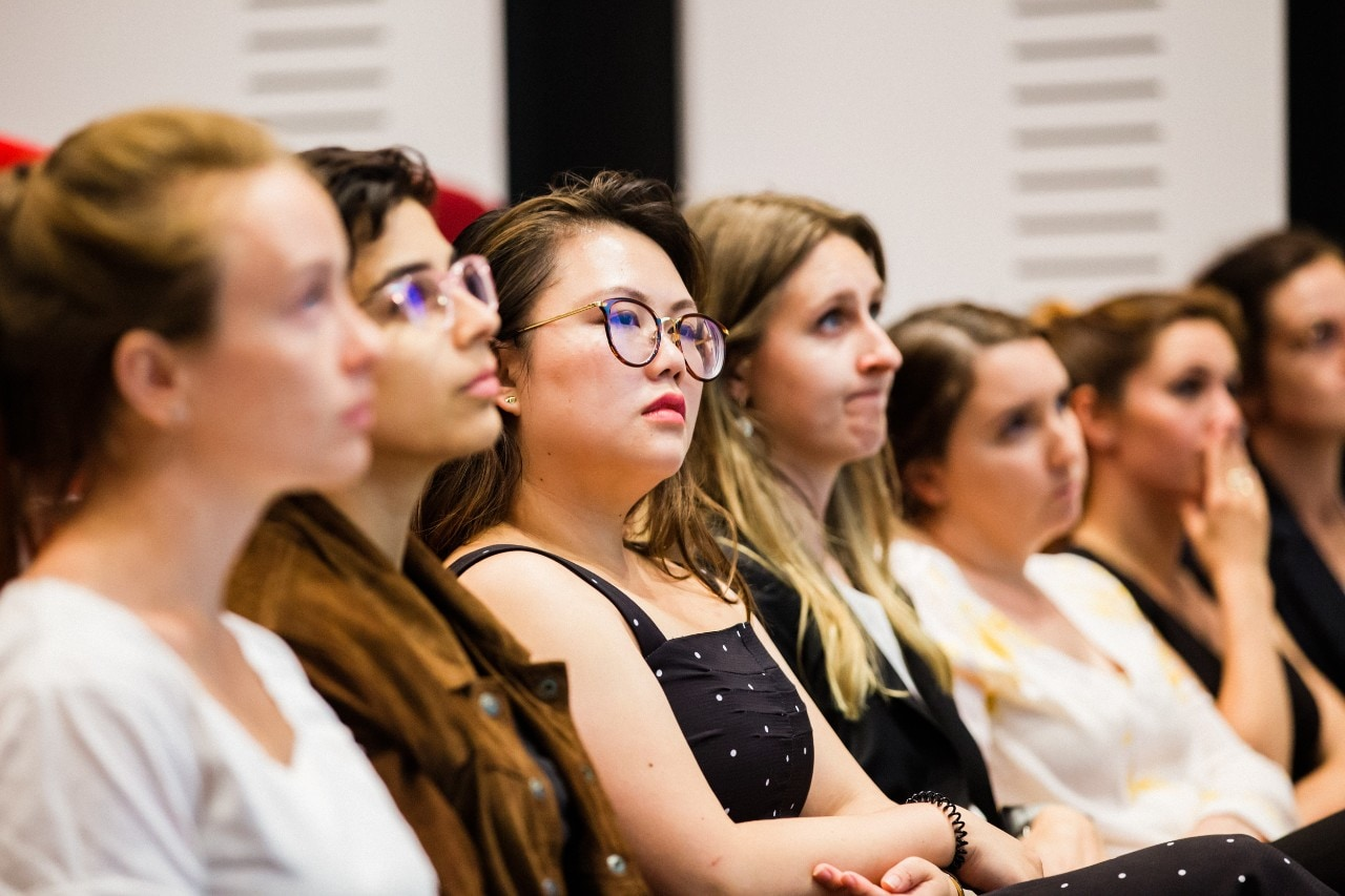 Young women in the audience at a Sydney Ideas event.