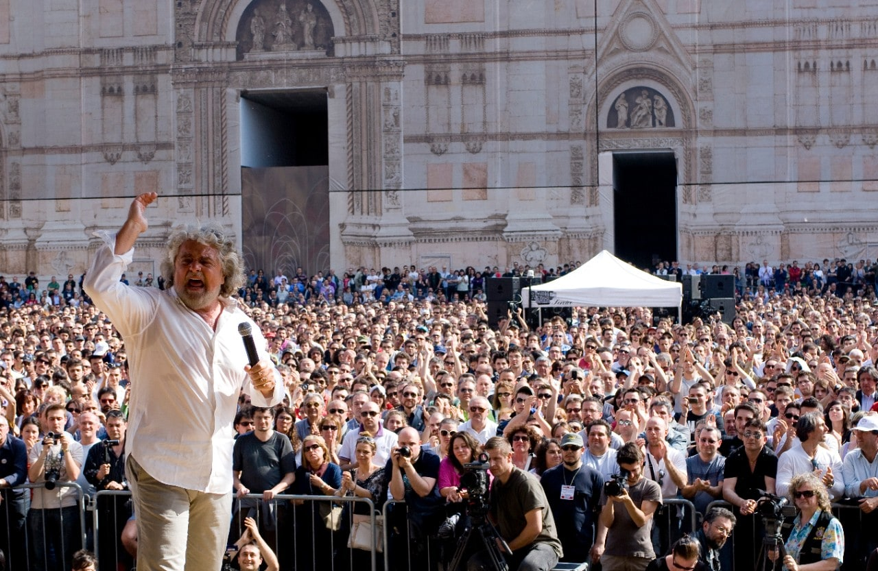 Italian comedian and politician Beppe Grillo talking to crowd