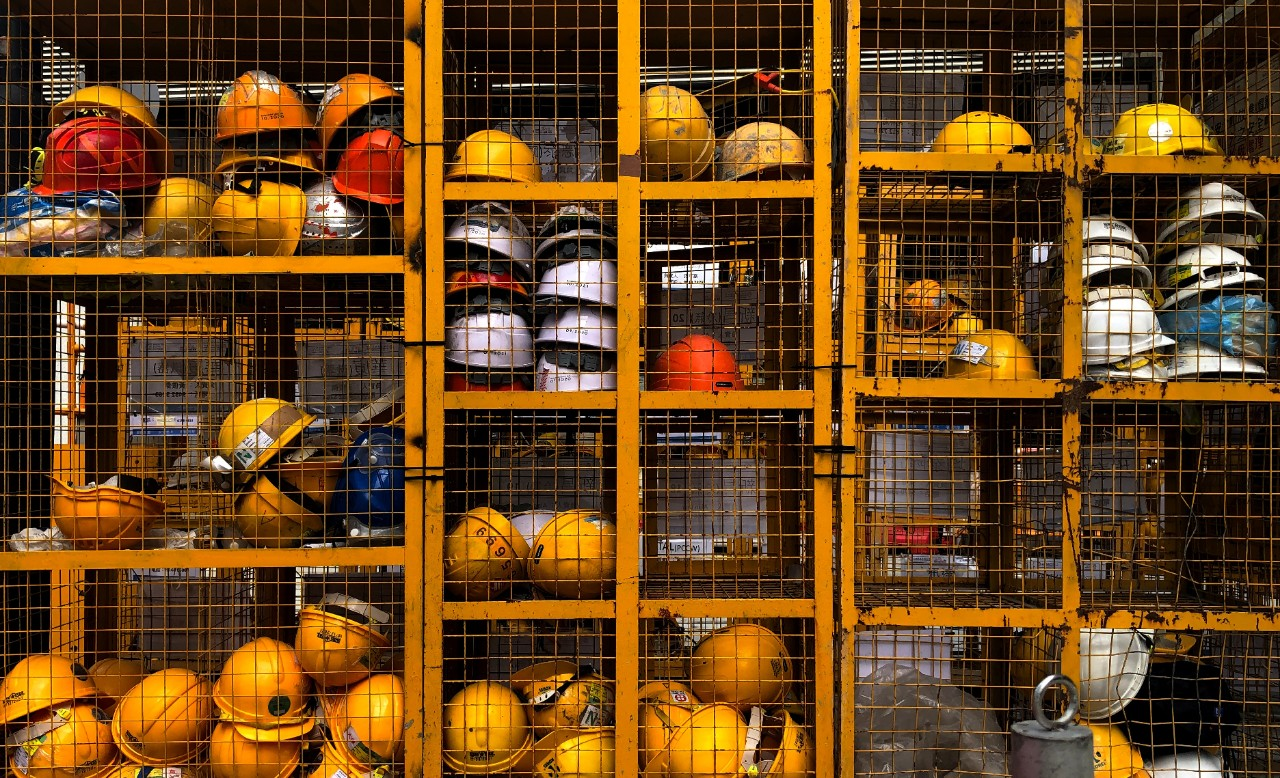Hard hats in cage
