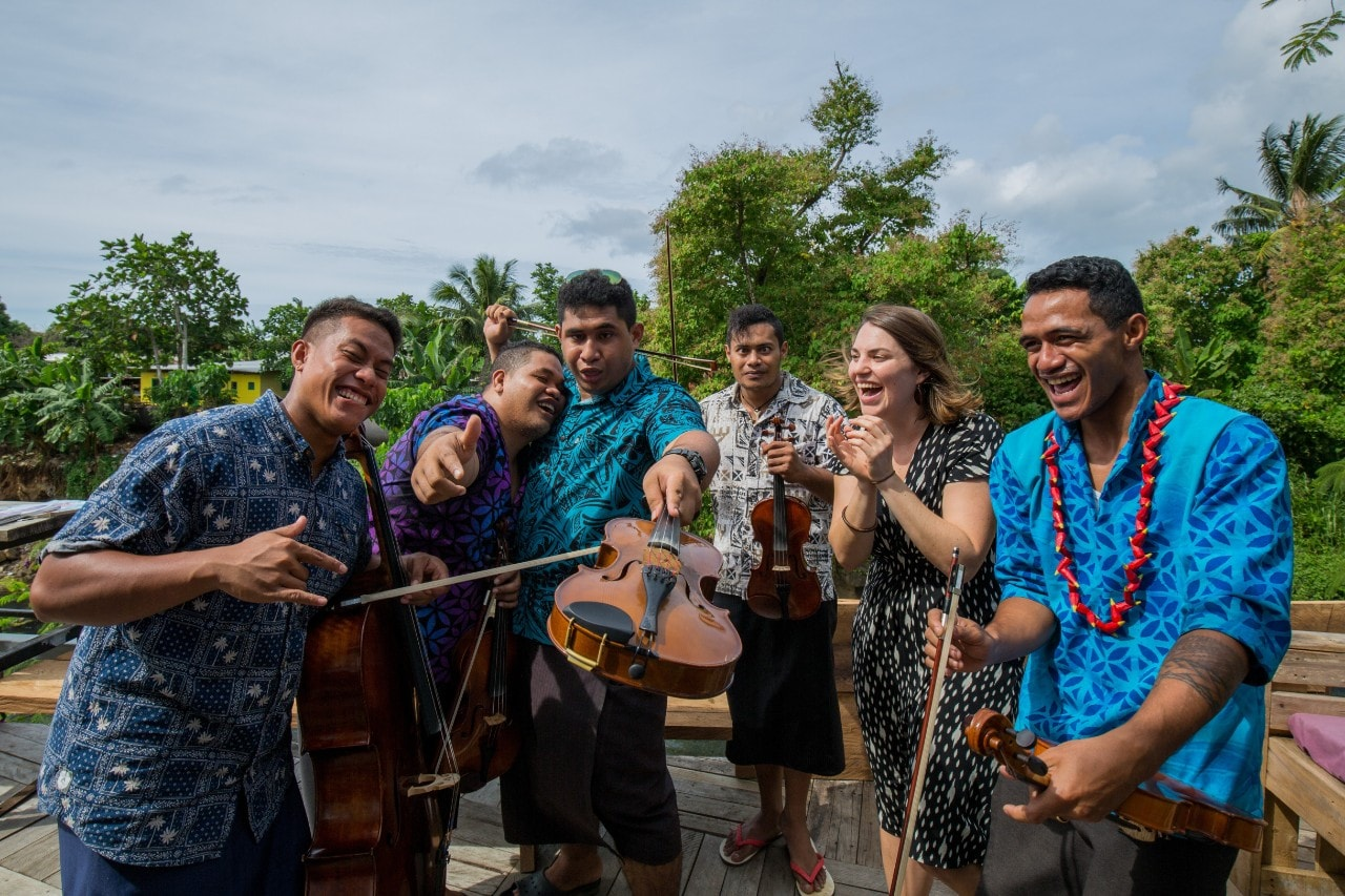 Beatrice Carey with members of the Samoan Orchestra