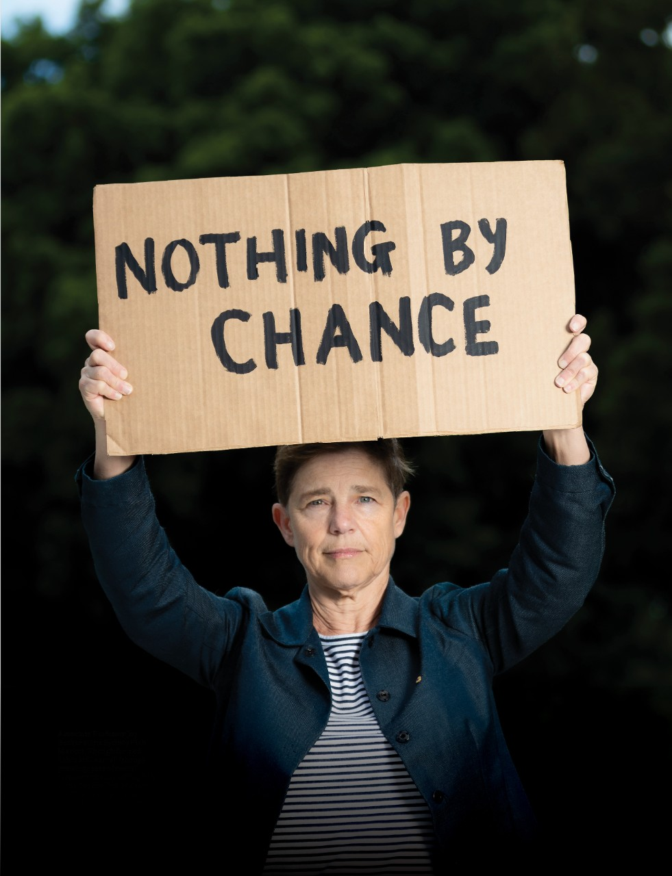Rebecca Peters holding a placard saying 'nothing by chance'