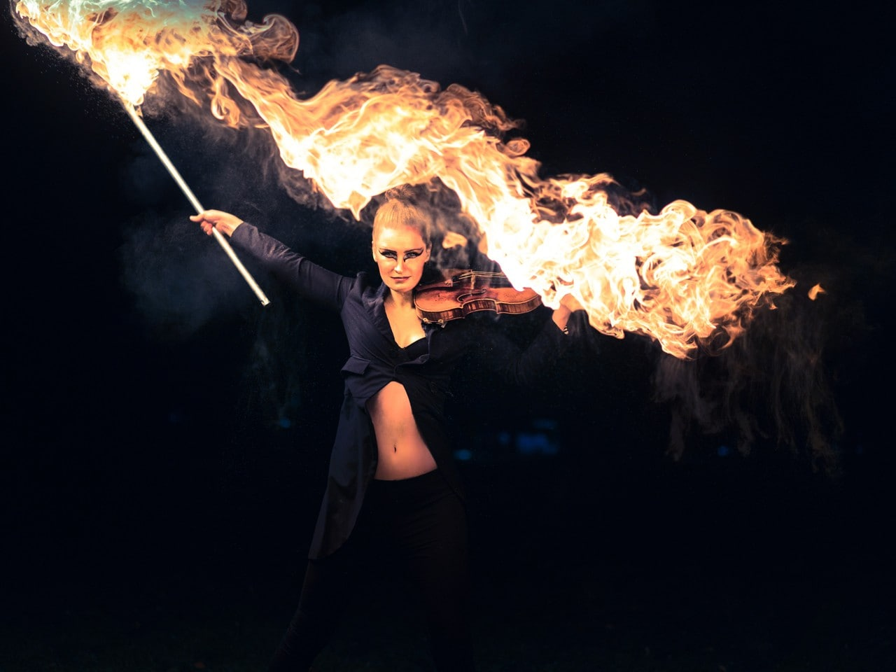 Female performing with violin and fire