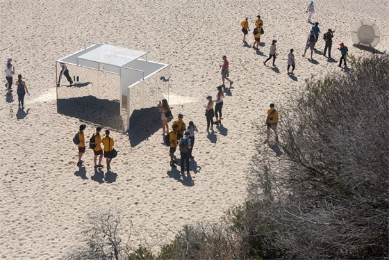 Sophie Lanigan and Isobel Lord's pavilion, 'Temple', on the beach surrounded by crowds at Sculptures by the Sea