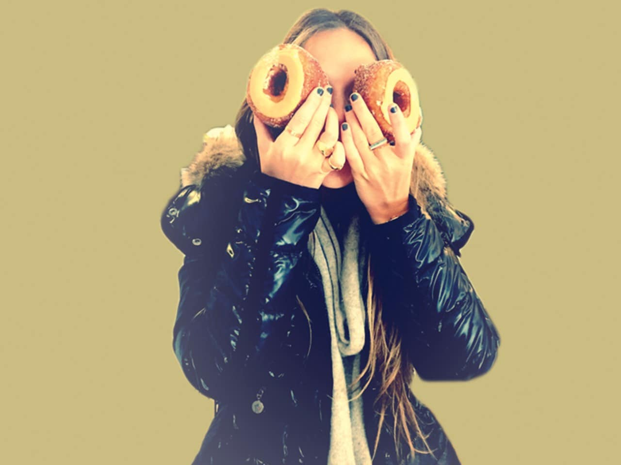 Photo of girl with donuts covering her eyes