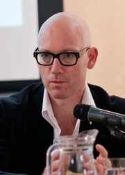 Profile image of the author - Professor Dirk Moses - sat at a microphone.