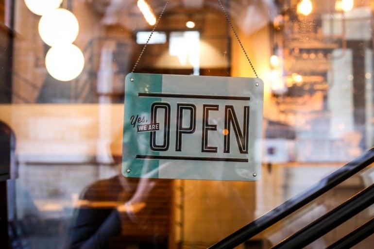 Photo of open sign on door