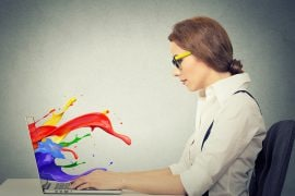 Image of laptop with vibrant colour splashing out of screen