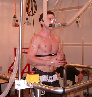 Man running on treadmill with breathing apparatus