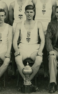 An image of John Treloar in his role as captain of the Univesity Athletics Club