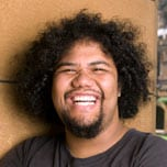 Photo of a smiling student in the quadrangle