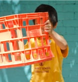 Photo of children playing with recycled crates