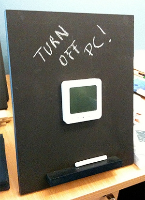 In each house, a small blackboard with a digital display monitor presented daily kilowatt usage.