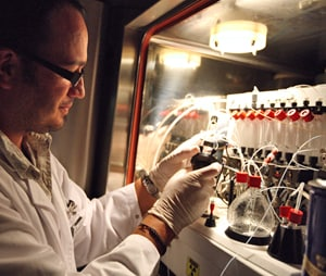 A radiochemist preparing the  reagents for synthesising a radiopharmaceutical.