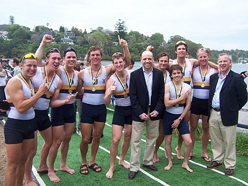 Winners of the inaugural Australian Boat Race, University of Sydney men's eight with Federal Minister for Sport Sen. Mark Arbib, (centre) and Vice-Chancellor Dr Michael Spence (right).