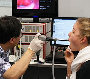 A patient being scoped using the High Speed Laryngoscopy Unit.
