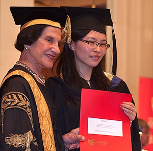 Chancellor Her Excellency Professor Marie Bashir with one of the Chinese graduates.