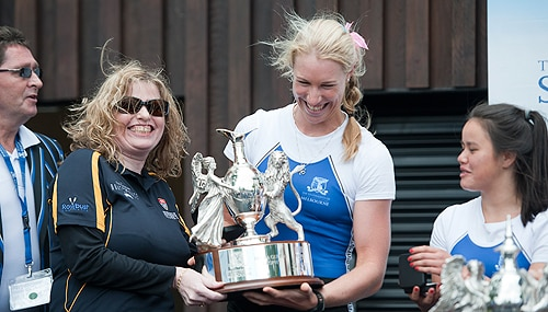 Captain of the Melbourne's women's eight, Kim Crow, receives the  trophy.