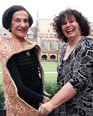 Lynette Riley (right) presented Professor Marie Bashir with a Wiradjuri Cloak made from kangaroo skin as a gift from Aboriginal and Torres Strait Islander staff at the University.