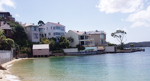 Waterfront homes are at risk of rising sea levels due to climate change.