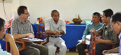 Professor Philip Hirsch (far left) meeting with local Laotians.